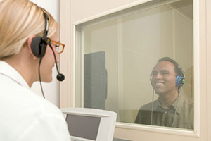 Audiologist giving hearing test