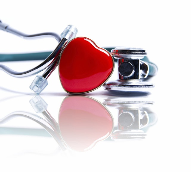 Plastic heart and a stethoscopes