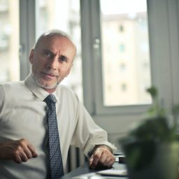 Older man with hearing loss listening